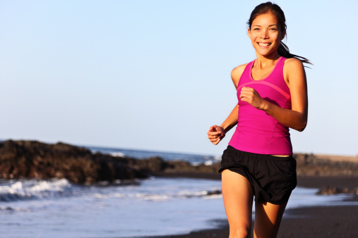 Runner running on beach